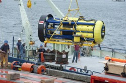 The Ocean Observatories Initiative team loads the Global Hybrid Profiler on Research Vessel Oceanus for the At Sea Test off the New England Coast. (Credit: Tom Kleindinst, Woods Hole Oceanographic Institution)