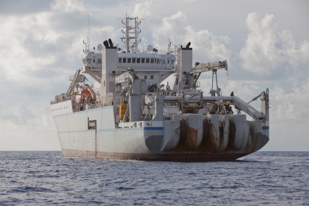 A commercial cable-laying ship, the TE Subcom Dependable, makes way to install the Ocean Observatories Initiative (OOI) program's backbone cable off the coast of Oregon. The undersea cable will link scientists and others on land to data streaming from an extensive array of next generation sensors located in the ocean and on the seafloor.