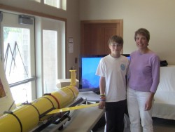 Stephanie Welch and her son Issak Welch check out a glider on display at the Ocean Observatories Initiative Open House in Pacific City, Oregon.