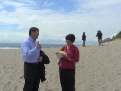 Tim Cowles, Vice President & Director of Ocean Observing at the Consortium for Ocean Leadership, discusses the OOI program with Headlight Herald reporter Mary Faith Bell near the beach cable landing site.