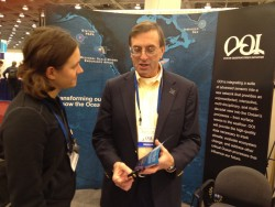 Tim Cowles, Vice President and Director of Ocean Observing, discusses the Ocean Observatories Initiative with Dr. Natalie Griffiths, Postdoctoral Research Associate, Oak Ridge National Laboratory, at the OOI booth during the American Geophysical Union fall meeting in San Francisco, Calif., in December. (Credit: OOI Program Management Office Communications)