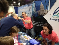 Megan Gibney and Adam Anderson of the Ocean Observatories Initiative Program demonstrate how measure salinity in ocean samples for visitors interested in the OOI's data collection capabilities at the 2012 USA Science & Engineering Festival.