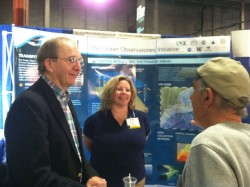 Wendell Brown, professor at University of Massachusetts Dartmouth, Department of Estuarine and Ocean Science, and Merrie Beth Neely, OOI Science and Environmental Compliance Manager, talk about the Pioneer Array component of the OOI at the 2012 Commercial Marine Expo in New Bedford, MA. (Credit: Stephanie Murphy, Woods Hole Oceanographic Institution)