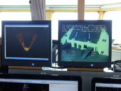 Screen monitors on the bridge of the TE SubCom CS Dependable show sonar and video displays from the ROV Nereus 3 during final inspection of node PN1B. Note the node sitting nice and flat on the seabed in video display. Photo by Cecile Durand