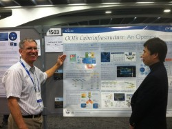 John Graybeal, Product Manager of the OOI Cyberinfrastructure (CI) presents a poster explaining the basics of the OOI Cyberinfrastructure, (Photo Credit: Debi Kilb, CI Communications)
