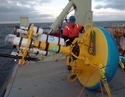 Upstream Offshore Profiler Mooring surface buoy is prepared for deployment. (Photo Credit John Lund, Woods Hole Oceanographic Institution)