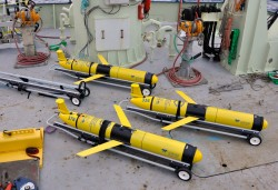 Three OOI gliders await deployment as a part of the Pioneer Array. Gliders are brought on deck for pre-deployment checks. Specially designed carts are used to lower them into the water and release them, after which flight control is taken over by pilots on shore. (Photo Credit: Sheri White WHOI/CGSN)
