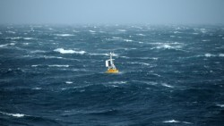 The Argentine Basin Surface Mooring buoy bobs with the waves after being deployed in over 3 miles of water (5.2km). (Photo Credit: OOI Coastal Global Scale Nodes program Argentine Basin deployment team)