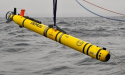 A notable accomplishment on the Pioneer-4 cruise was deployment of the Pioneer REMUS-600 Autonomous Underwater Vehicle (AUV). The AUV conducted a cross-frontal transect coordinated with a seven-station shipboard CTD survey. (Photo: Sheri White, WHOI/CGSN)