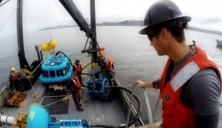 The Endurance Array Oregon Line Inshore Surface Mooring near surface instrument frame is prepared for lowering over the side.  The mooring was deployed in 25 meters of water off the coast of Oregon.  (Photo credit: David Baker, Oregon State University)